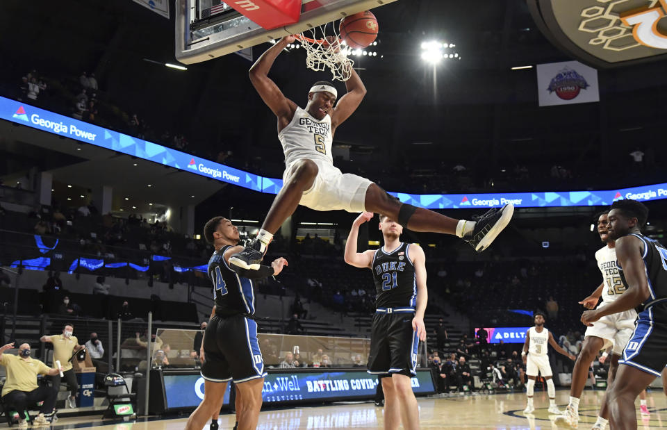 FILE - Georgia Tech forward Moses Wright (5) hangs from the basket after dunking against Duke during the second half of an NCAA college basketball game in Atlanta, in this March 2, 2021, file photo. Wright is The Associated Press men's basketball player of the year for the Atlantic Coast Conference and a member of the All-ACC first team in voting announced Tuesday, March 9, 2021. (Hyosub Shin/Atlanta Journal-Constitution via AP, File)