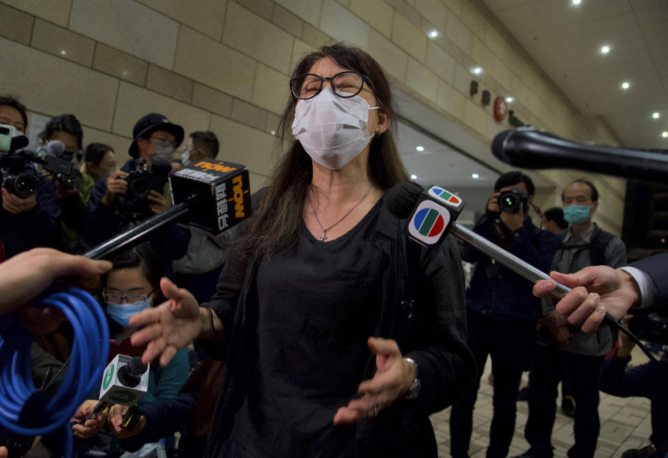 A relative of one of the 47 pro-democracy activists reacts outside a court in Hong Kong Thursday, March 4, 2021. A Hong Kong court on Thursday remanded all 47 pro-democracy activists charged under a Beijing-imposed national security law in custody, ending a four-day marathon court hearing. (AP Photo/Vincent Yu)
