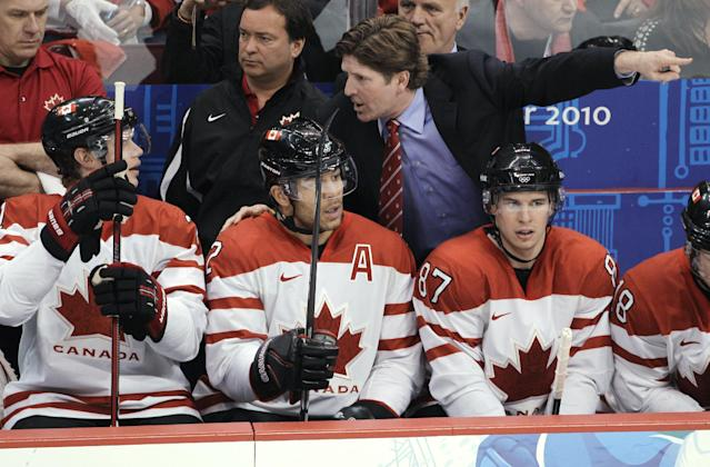 FILE - In this Feb. 28, 2010, file photo, Canada coach Mike Babcock speaks with players Eric Staal, Jarome Iginla, center, and Sidney Crosby (87) during the men's gold medal ice hockey game at the 2010 Olympics in Vancouver, British Columbia. Canada won the gold on home ice in 2010; now Babcock will try to lead the team to victory in Sochi. (AP Photo/Mark Humphrey, File)