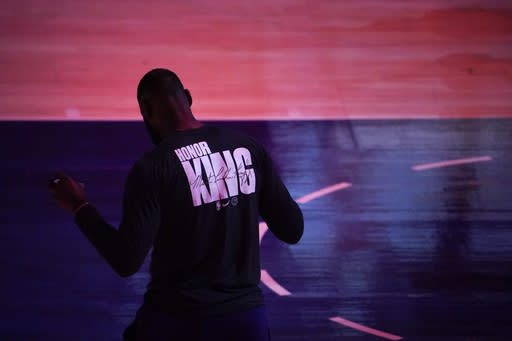 Los Angeles Lakers' LeBron James wears a T-shirt honoring Martin Luther King Jr. before the team's NBA basketball game the Golden State Warriors, Monday, Jan. 18, 2021, in Los Angeles. (AP Photo/Jae C. Hong)