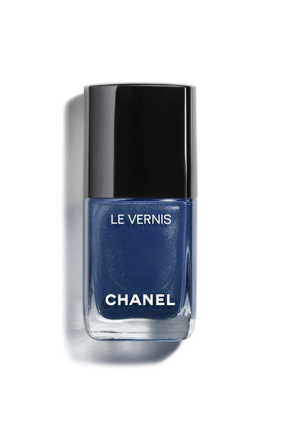 """<p><strong>Chanel Le Vernis Nail Color in Radiant Blue</strong></p><p>barneys.com</p><p><strong>$28.00</strong></p><p><a href=""""https://www.barneys.com/product/chanel-le-vernis-nail-color-506399710.html?gclid=Cj0KCQjw5rbsBRCFARIsAGEYRwcb8DPYHzh_uUolSEYsqjjDb2PLhTlYY7uFNYb0mo9Not5GYt6cGn0aAh4_EALw_wcB&gclsrc=aw.ds"""" rel=""""nofollow noopener"""" target=""""_blank"""" data-ylk=""""slk:SHOP IT"""" class=""""link rapid-noclick-resp"""">SHOP IT</a></p><p>Put your basic black shade you always wear down, and try this sophisticated sapphire that'll look just as chic. </p>"""