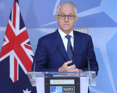 FILE PHOTO: Australian Prime Minister Turnbull speaks at a news conference after a meeting with NATO Secretary-General Stoltenberg at the Alliance's headquarters in Brussels