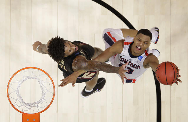 Gonzaga guard Zach Norvell Jr., right, shoots against Florida State forward Phil Cofer during the first half of an NCAA men's college basketball tournament regional semifinal Thursday, March 22, 2018, in Los Angeles. (AP Photo/Alex Gallardo)