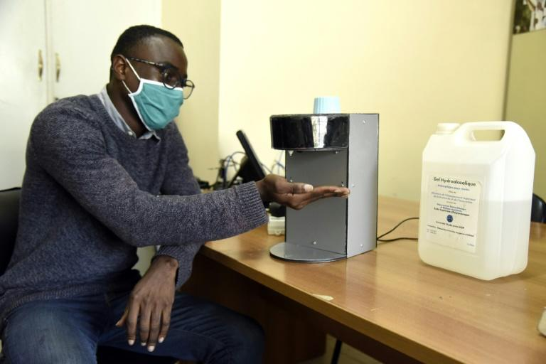 """Gianna Andjembe is working on an automatic sanitiser dispenser and says """"we have to meet the challenges and really take our destiny into our own hands"""" (AFP Photo/Seyllou)"""