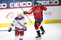 Washington Capitals left wing Alex Ovechkin, right, celebrates his goal next to New York Rangers center Ryan Strome (16) during the second period of an NHL hockey game, Sunday, March 28, 2021, in Washington. (AP Photo/Nick Wass)