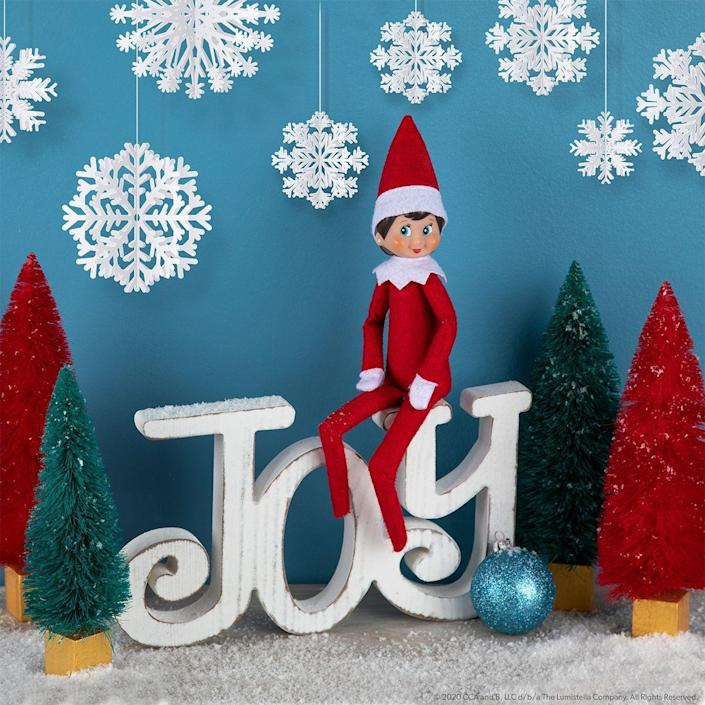 """<p>Decorate your mantel with Christmassy accessories, then watch and wait for your Scout Elf's return. How could he resist landing in such a pretty space?</p><p><strong>Get the tutorial at <a href=""""https://elfontheshelf.com/elf-ideas/returning-home/"""" rel=""""nofollow noopener"""" target=""""_blank"""" data-ylk=""""slk:Elf on the Shelf"""" class=""""link rapid-noclick-resp"""">Elf on the Shelf</a>.</strong></p>"""