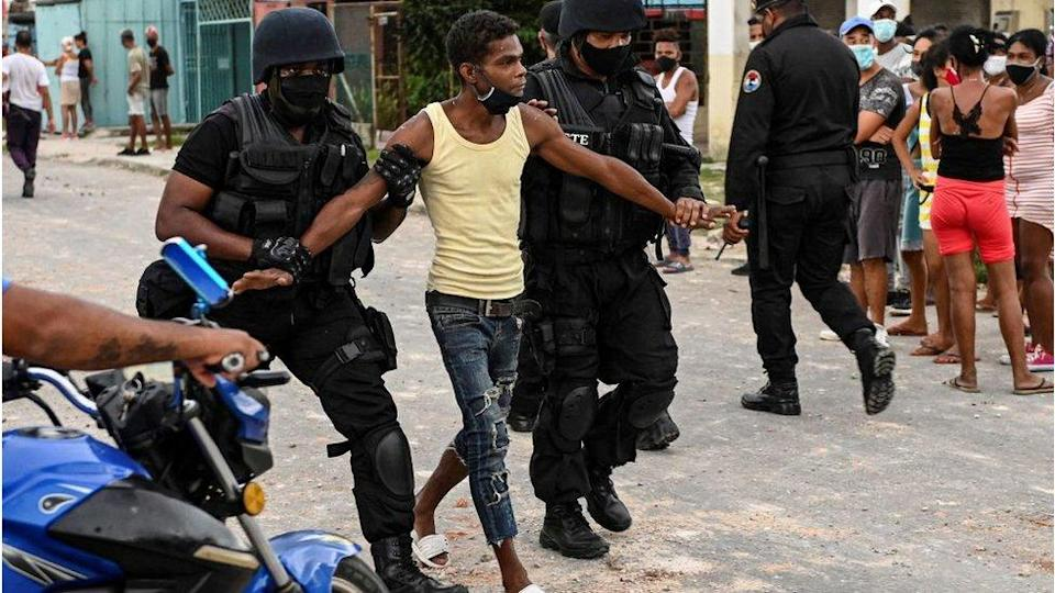A protester being arrested in Cuba