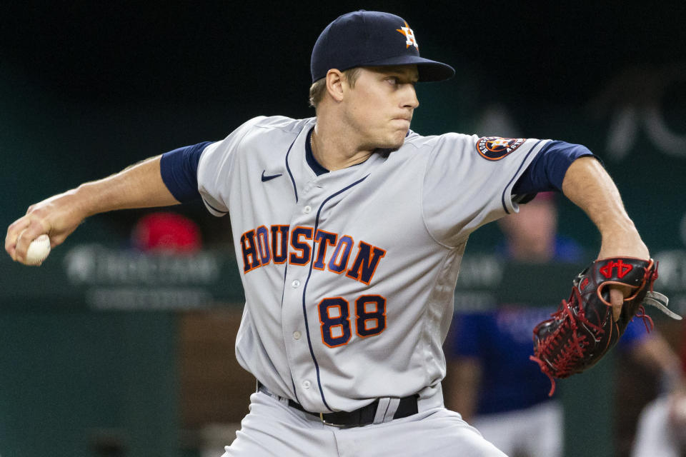 Houston Astros relief pitcher Phil Maton throws during the sixth inning of a baseball game against the Texas Rangers, Friday, Aug. 27, 2021, in Arlington, Texas. (AP Photo/Sam Hodde)