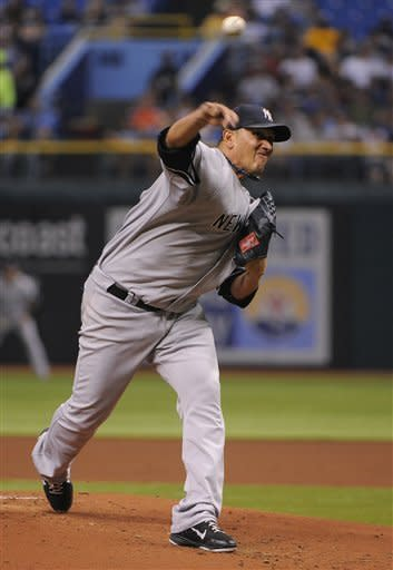 New York Yankees pitcher Freddy Garcia delivers to the Tampa Bay Rays during the first inning of a baseball game Monday, July 2, 2012, in St. Petersburg, Fla. (AP Photo/Brian Blanco)