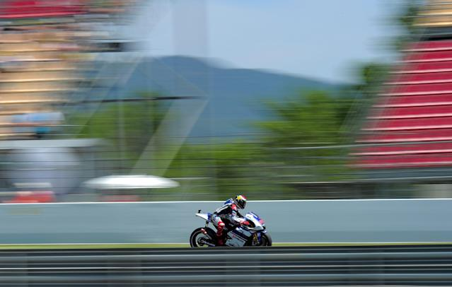 Yamaha Factory Racing's Spanish Jorge Lorenzo rides at the Catalunya racetrack in Montmelo, near Barcelona, on June 2, 2012, during the MotoGP qualifying session of the Catalunya Moto GP Grand Prix. AFP PHOTO / JOSEP LAGOJOSEP LAGO/AFP/GettyImages