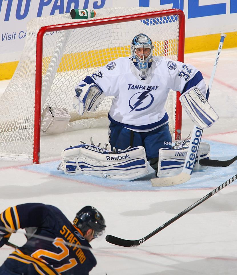 BUFFALO, NY - OCTOBER 25: Mathieu Garon #32 of the Tampa Bay Lightning awaits a shot by Drew Stafford #21 of the Buffalo Sabres at First Niagara Center on October 25, 2011 in Buffalo, New York.  (Photo by Rick Stewart/Getty Images)