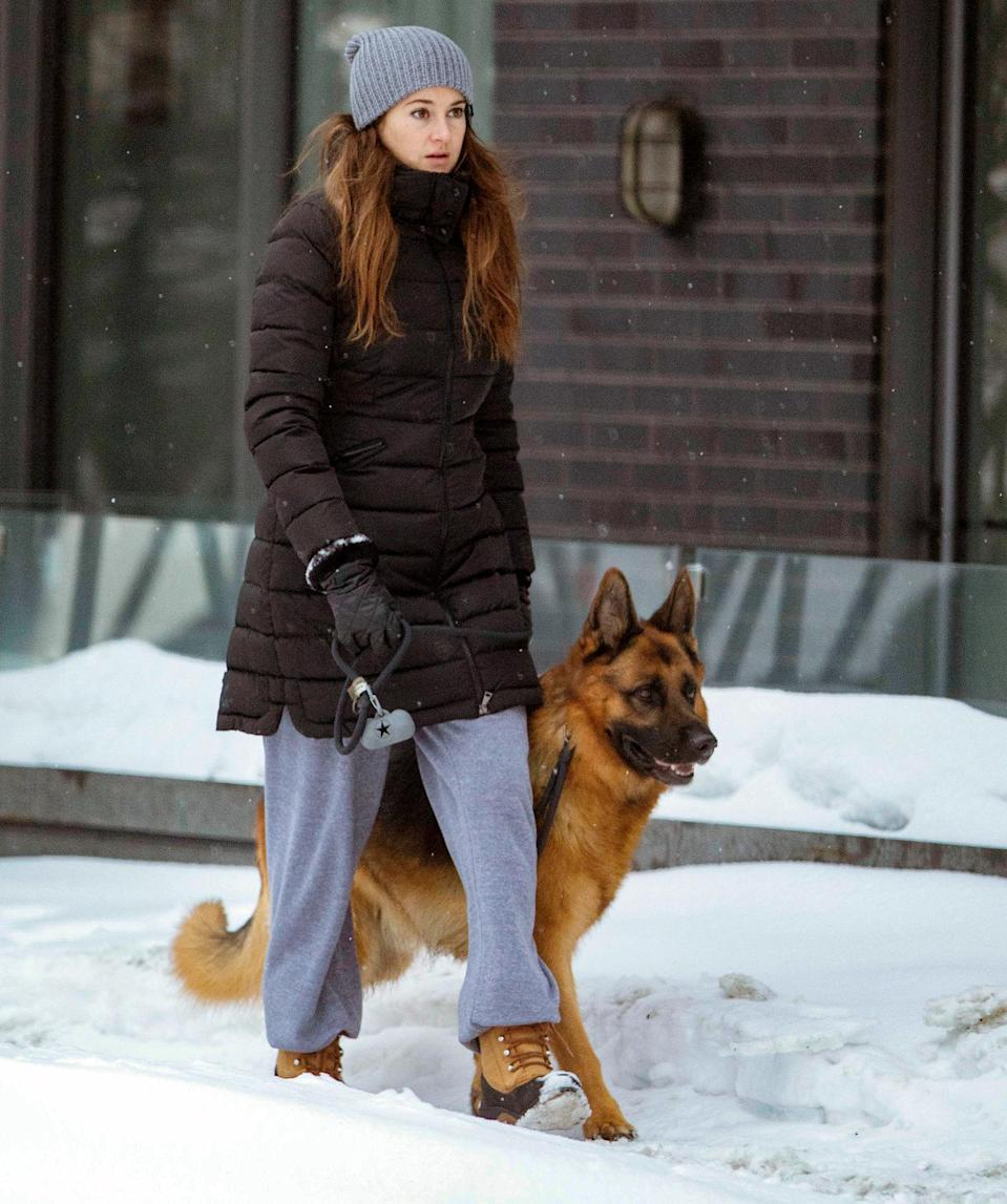 <p>Shailene Woodley and her pup are bundled up as they walk through Montreal, Canada, on Friday.</p>
