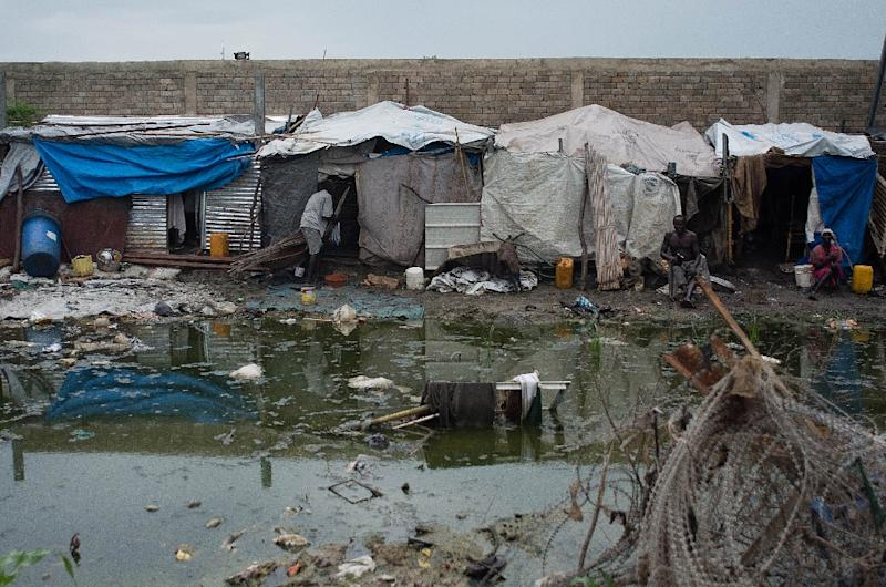 Makeshift shelters next to a mosquito infested pond on August 1, 2014 at the UN Protection of Civilians (PoC) site in Upper Nile State capital Malakal, South Sudan (AFP Photo/Charles Lomodong)