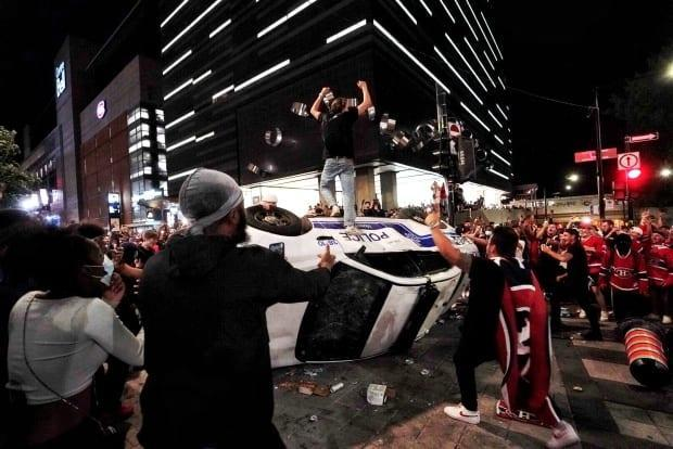 Some Habs fans in Montreal celebrated the Canadien's series-clinching win by flipping a police car. Police responded by shooting tear gas into the crowd.            (Ivanoh Demers/Radio-Canada - image credit)