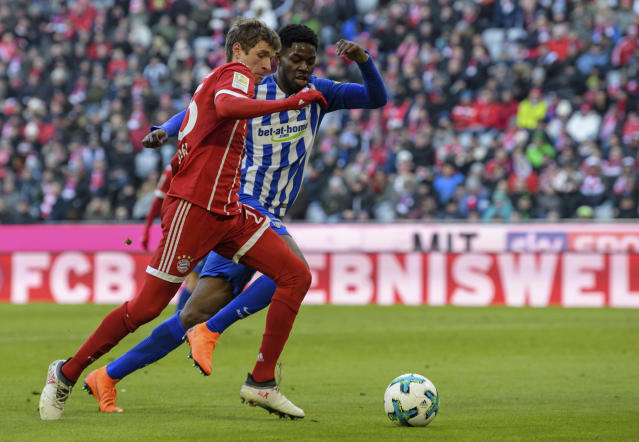 Bayern's Thomas Mueller and Hertha's Jordan Torunarigha, right, challenge for the ball during the German Bundesliga soccer match between FC Bayern Munich and Hertha BSC Berlin in Munich, southern Germany, Saturday, Feb. 24, 2018. (Matthias Balk/dpa via AP)