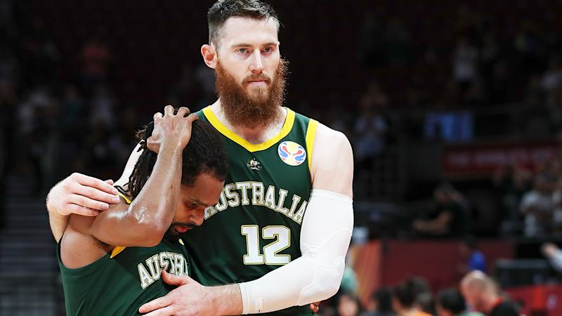 Aron Baynes consoles Patty Mills after Australia lost to Spain, 95-88, in the FIBA World Cup semi-final. (Photo by Lintao Zhang/Getty Images)