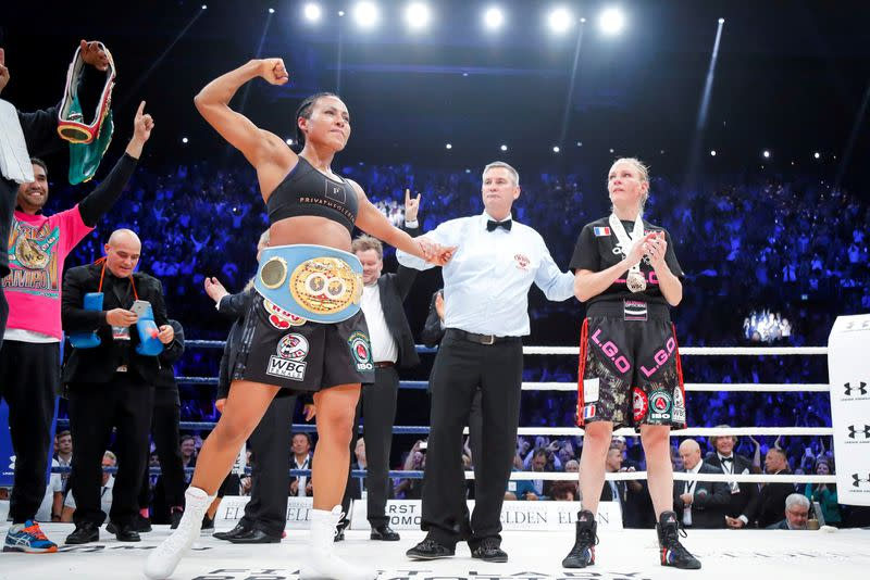 FILE PHOTO: Cecilia Braekhus of Norway celebrates after winning the boxing match against Anne-Sophie Mathis of France during the boxing event The Homecoming in Oslo Spektrum in Oslo