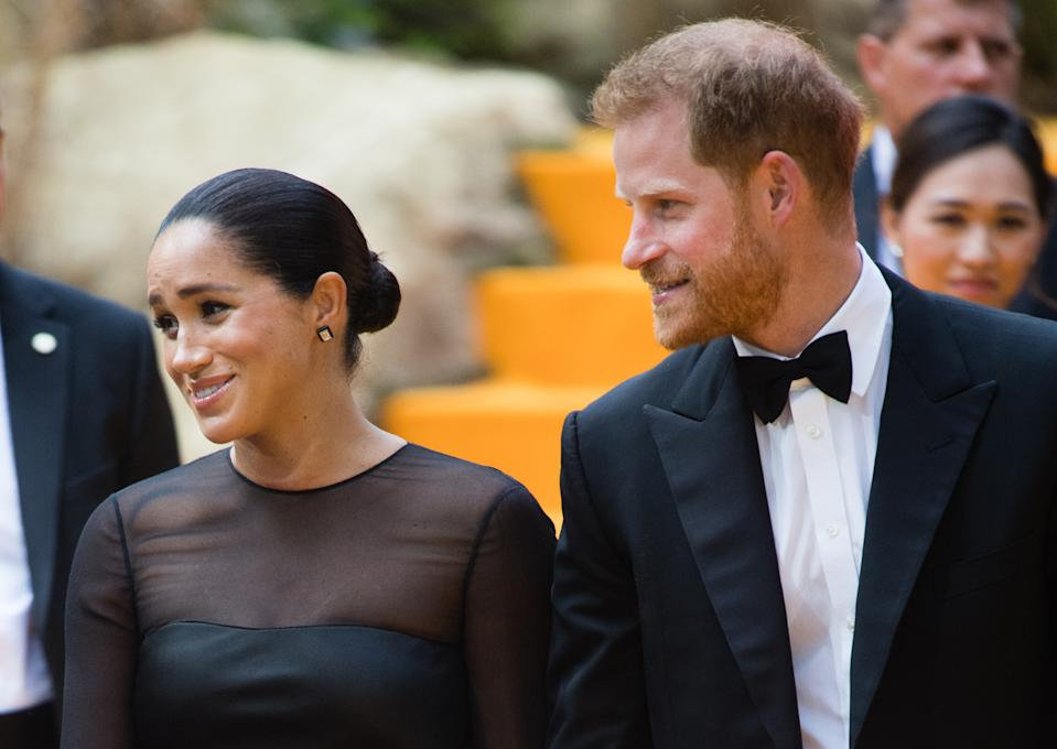 "LONDON, ENGLAND - JULY 14: Prince Harry, Duke of Sussex and Meghan, Duchess of Sussex attend ""The Lion King"" European Premiere at Leicester Square on July 14, 2019 in London, England. (Photo by Samir Hussein/WireImage)"