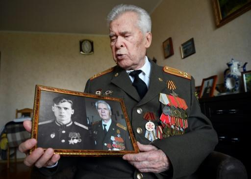 WWII veteran Colonel Alexander Glagolev, 94, shows a photograph of him dated 1948
