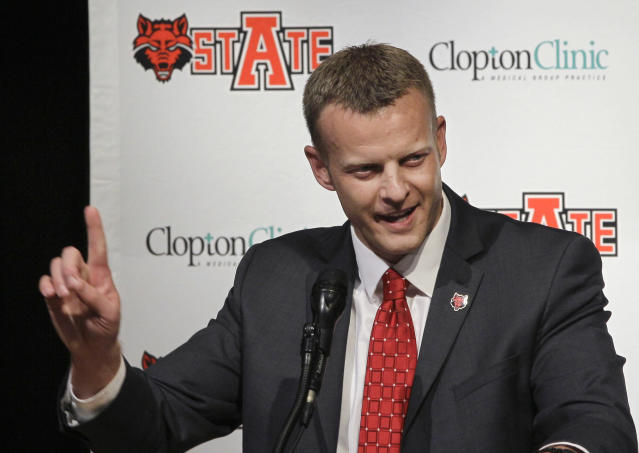 FILE - In this Dec. 12, 2012 file photo, Arkansas State head coach Bryan Harsin speaks during an NCAA college football news conference in Jonesboro, Ark. A person familiar with the decision tells The Associated Press that Boise State has hired Harsin as its next coach. The person spoke on condition of anonymity because the move had not become official. (AP Photo/Danny Johnston, File)