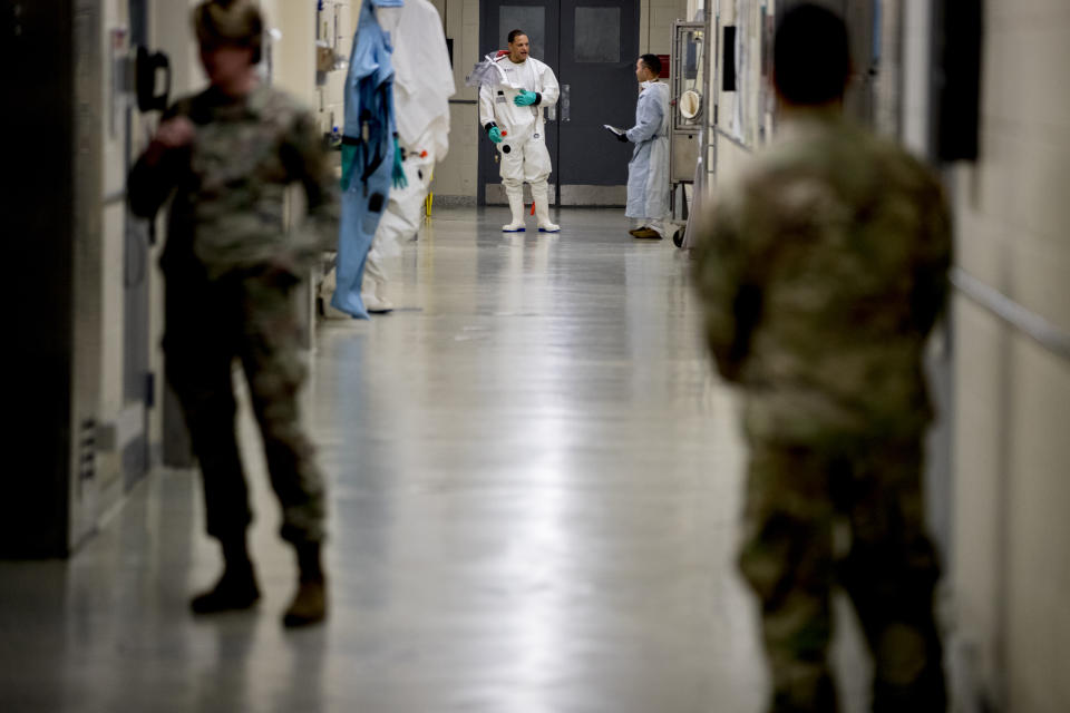 Biological science specialist in a biosafety suit at the US Army Medical Command at Fort Detrick. Source: AAP