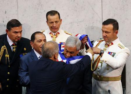 Chile's newly sworn in President Sebastian Pinera receives the sash from President of the Senate Carlos Montes at the Congress in Valparaiso, Chile March 11, 2018. REUTERS/ Ivan Alvarado