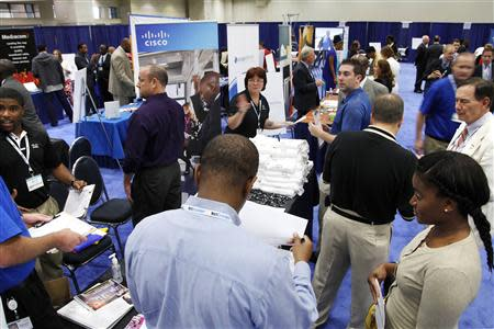 Jobseekers talk with recruiters at a Hire Our Heroes job fair in Washington, in this file photo taken June 11, 2013. U.S. private employers added 176,000 jobs in August, nearly matching economists' expectations for the month, a report by a payrolls processor showed on Thursday. REUTERS/Jonathan Ernst/Files