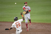 Los Angeles Angels second baseman David Fletcher throws to first base for an out on a ball hit by Baltimore Orioles' Ryan Mountcastle against Los Angeles Angels starting pitcher Dylan Bundy during the second inning of a baseball game Tuesday, Aug. 24, 2021, in Baltimore. (AP Photo/Terrance Williams)