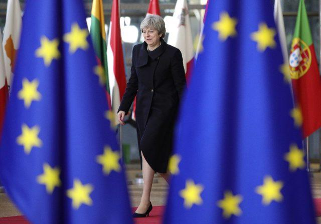 Theresa May arrives for an EU summit (Olivier Matthys/AP)
