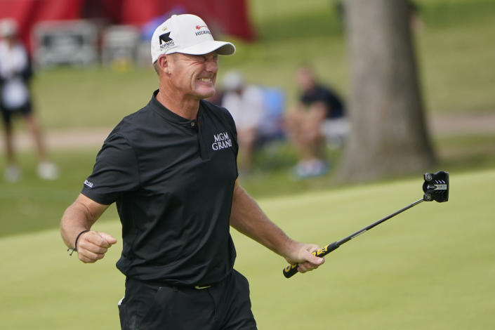 FILE - Alex Cejka celebrates on the 18th green after winning the Senior PGA Championship golf tournament in Tulsa, Okla., in this Sunday, May 30, 2021, file photo. The PGA Tour Champions newcomer already has wins in two senior majors and will go for a third this week in the U.S. Senior Open at Omaha Country Club. (AP Photo/Sue Ogrocki, File)