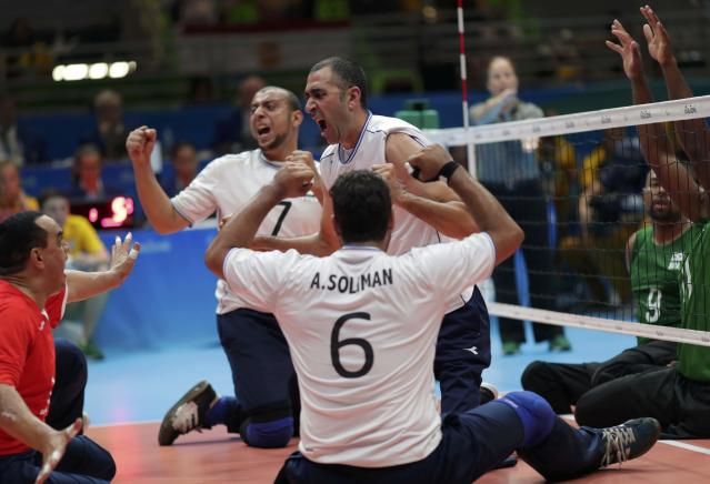 2016 Rio Paralympics - Sitting Volleyball - Men's Bronze Medal Match - Riocentro Pavilion 6 - Rio de Janeiro, Brazil - 18/09/2016. Players of team Egypt celebrate. REUTERS/Ueslei Marcelino FOR EDITORIAL USE ONLY. NOT FOR SALE FOR MARKETING OR ADVERTISING CAMPAIGNS.