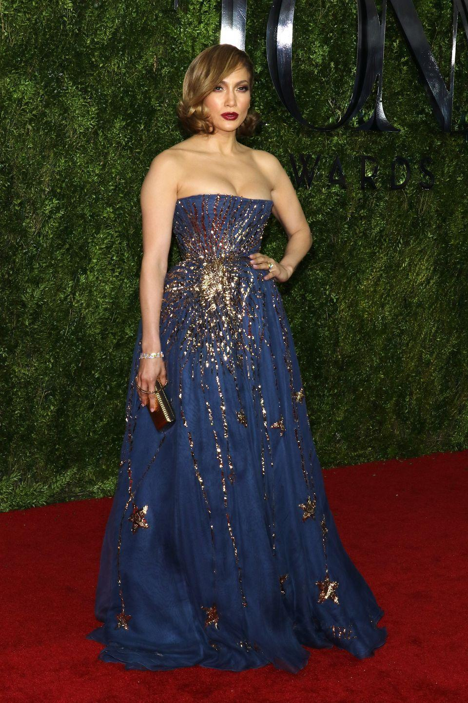 <p>Jennifer gives us major princess-y vibes in this embellished navy-and-gold Valentino gown at the Tony Awards. </p>