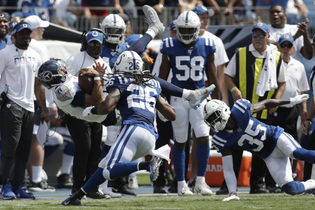 Tennessee Titans quarterback Marcus Mariota (8) flips as he is hit by Indianapolis Colts defenders including Clayton Geathers (26) and Pierre Desir (35) in the first half of an NFL football game Sunday, Sept. 15, 2019, in Nashville, Tenn. (AP Photo/James Kenney)