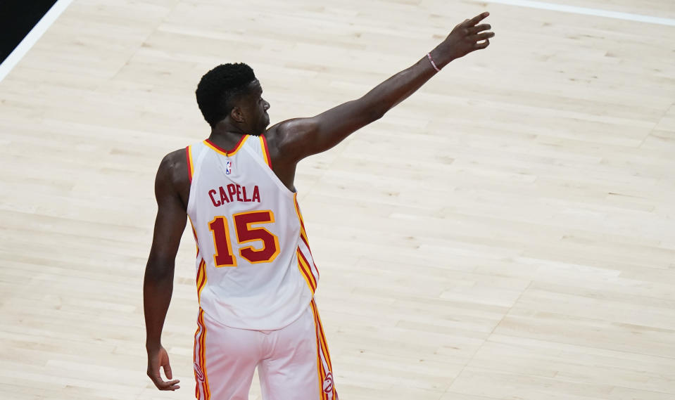 Atlanta Hawks center Clint Capela points in the crowd after scoring against the Indiana Pacers during the first half of an NBA basketball game on Sunday, April 18, 2021, in Atlanta. (AP Photo/Brynn Anderson)