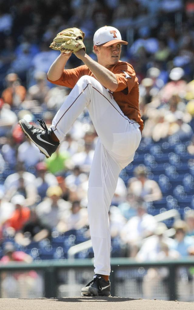 Texas starting pitcher Nathan Thornhill works against Vanderbilt in the first inning of an NCAA College World Series baseball game in Omaha, Neb., Friday, June 20, 2014. (AP Photo/Eric Francis)
