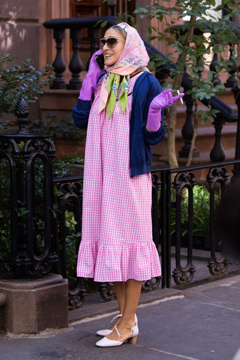 <p>A rather unusual choice for the fashion icon, one of her recent looks included a pink gingham midi dress, forearm-skimming purple latex gloves, a headscarf, sunglasses and heeled Mary Janes (which are undone in this snap). </p>