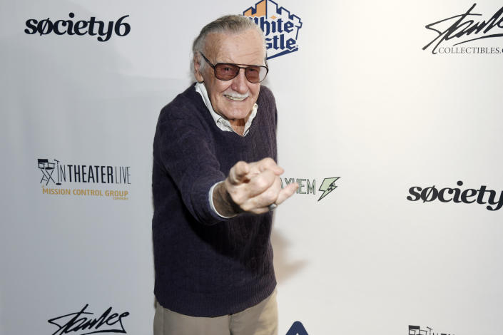"Stan Lee strikes a Spider-Man pose at the ""Extraordinary: Stan Lee"" tribute event in 2017. (Photo by Chris Pizzello/Invision/AP)"