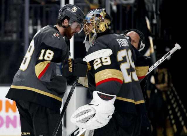 Vegas Golden Knights left wing James Neal, left, celebrates the team's 3-2 win with Marc-Andre Fleury after Game 4 of the NHL hockey Western Conference finals agains the Winnipeg Jets on Friday, May 18, 2018, in Las Vegas. (AP Photo/John Locher)