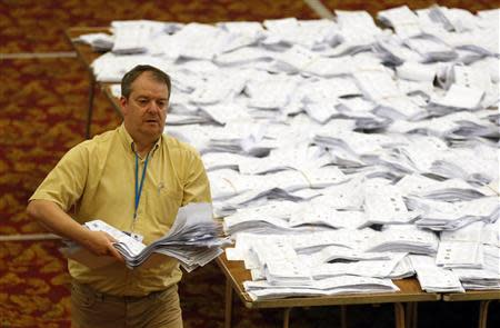 European Parliamentary election ballot papers, from the local area, are sorted as part of the count, in Southampton, southern England May 25, 2014. REUTERS/Luke MacGregor