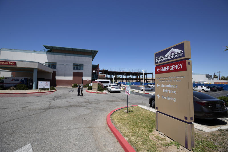 The El Centro Regional Medical Center is shown Wednesday, May 20, 2020, in El Centro, Calif. As much of California inches toward businesses reopening, this farming region on the state's border with Mexico is grappling with a spike in hospitalizations from the coronavirus that could inflict more pain on its perpetually struggling economy. (AP Photo/Gregory Bull)