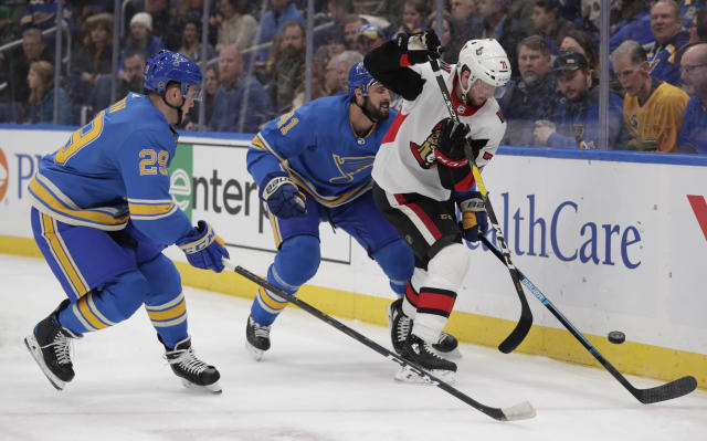 St. Louis Blues' Robert Bortuzzo (41) and Vince Dunn (29) battle Ottawa Senators' Chris Tierney (71) for the puck along the boards in the first period of an NHL hockey game, Saturday, Jan. 19, 2019, in St. Louis. (AP Photo/Tom Gannam)