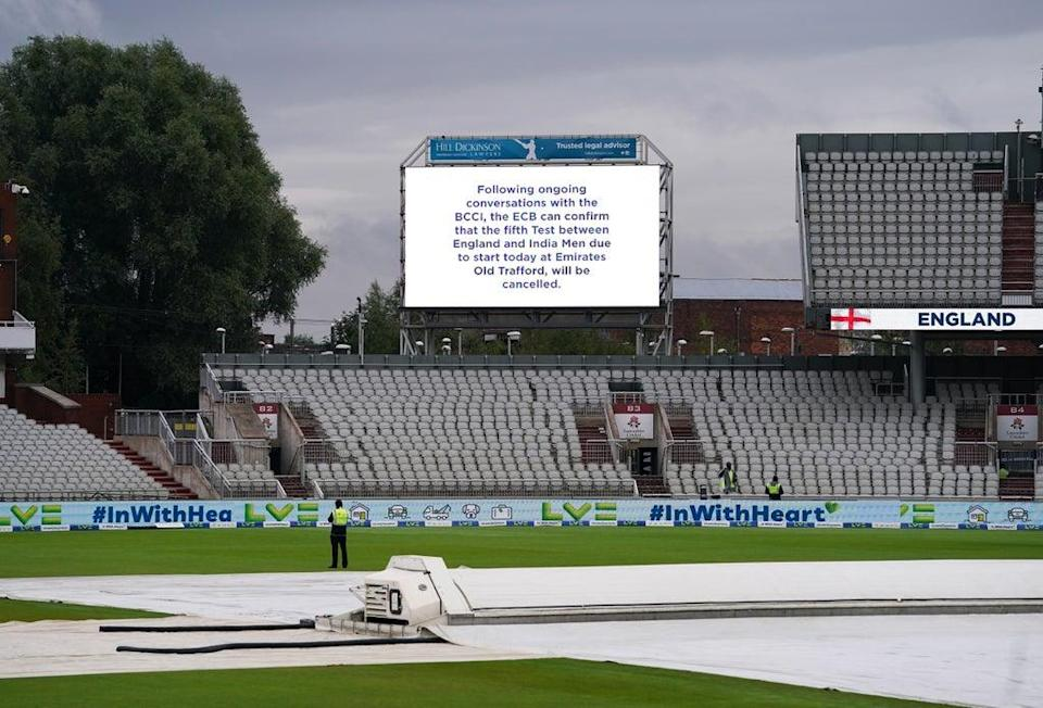 The big screen at an empty Emirates Old Trafford carries the news of the cancelled Test (Martin Rickett/PA) (PA Wire)