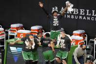 Boston Celtics guard Marcus Smart, top, and teammates on the bench celebrate a made basket by Tacko Fall during the fourth quarter of an NBA basketball game against the Orlando Magic, Friday, Jan. 15, 2021, in Boston. (AP Photo/Elise Amendola)