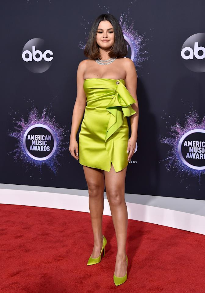 In addition to her duties as one of the evening's performers, Selena Gomez walked the red carpet, inspiring us to embrace a wardrobe of neon.