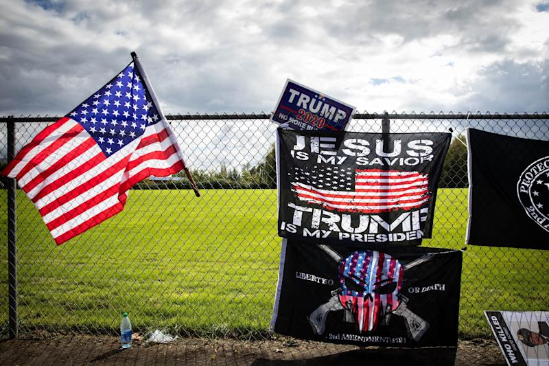 """Flags are draped along a fence at a Proud Boys rally at Delta Park in Portland, Oregon on September 26, 2020. - Far-right group """"Proud Boys"""" members gather in Portland to show support to US president Donald Trump and to condemn violence that have been occurring for more than three months during """"Black Lives Matter"""" and """"Antifa"""" protests. (Photo by Maranie R. STAAB / AFP) (Photo by MARANIE R. STAAB/AFP via Getty Images) (Photo: MARANIE R. STAAB via Getty Images)"""