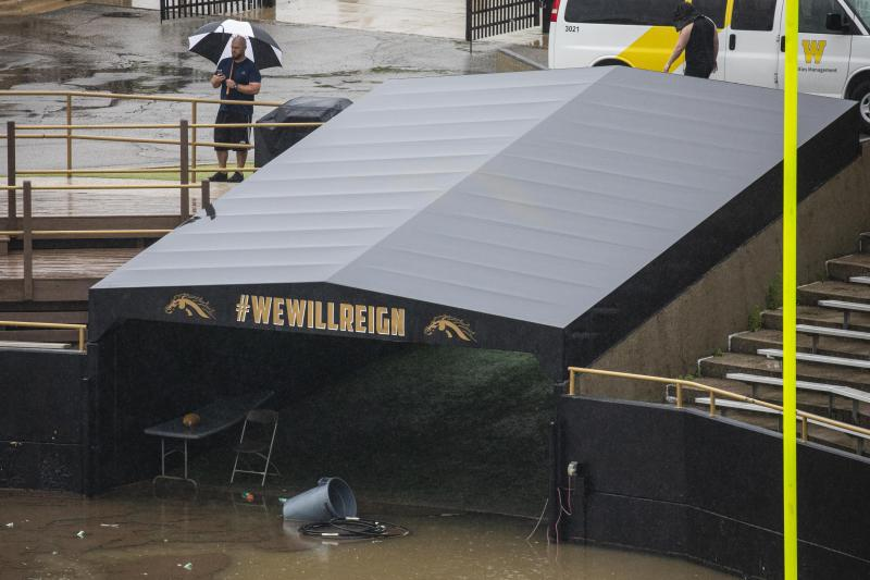 A man takes pictures of the flooded Waldo Stadium on the campus of Western Michigan University in Kalamazoo, Mich., Thursday, June 20, 2019. (Photo: Joel Bissell/Kalamazoo Gazette via AP)