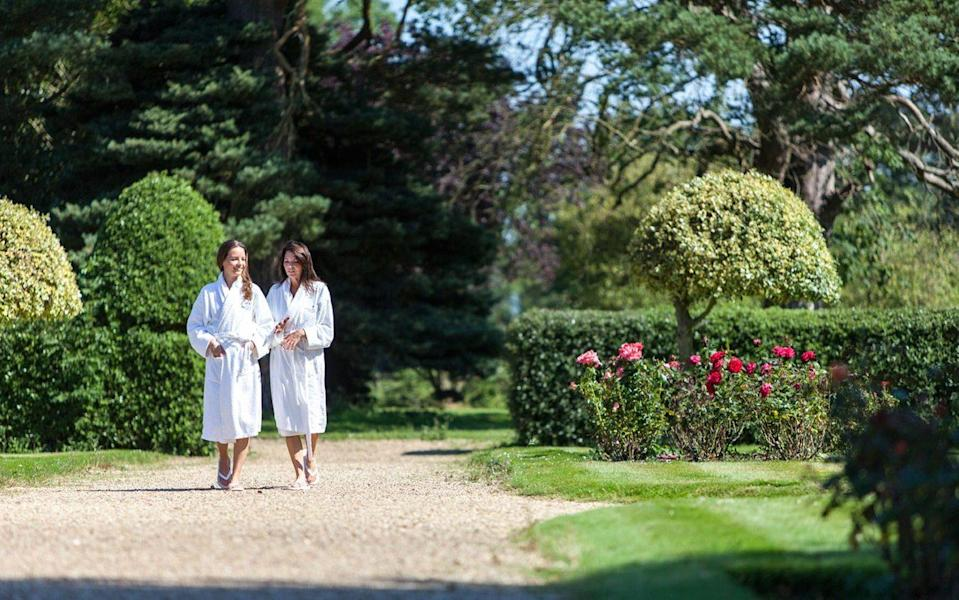 Two people walking the gardens at Champneys Tring - steve lancefield