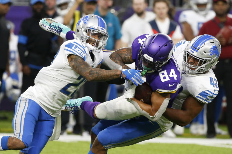 Minnesota Vikings tight end Irv Smith (84) is tackled by Detroit Lions defenders Darius Slay, left, and Devon Kennard, right, after catching a pass during the second half of an NFL football game, Sunday, Dec. 8, 2019, in Minneapolis. (AP Photo/Bruce Kluckhohn)