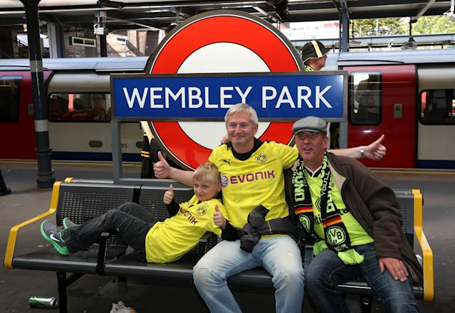 Borrussia Dortmund's fans pose at Wembley Park tube station before the Champions League Final at Wembley, London.