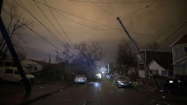 PHOTO: A resident makes her way down Underwood St. amidst downed trees and heavy debris on March 3, 2020 in Nashville, Tenn. A tornado passed through Nashville just after midnight leaving a wake of damage. (Brett Carlsen/Getty Images)